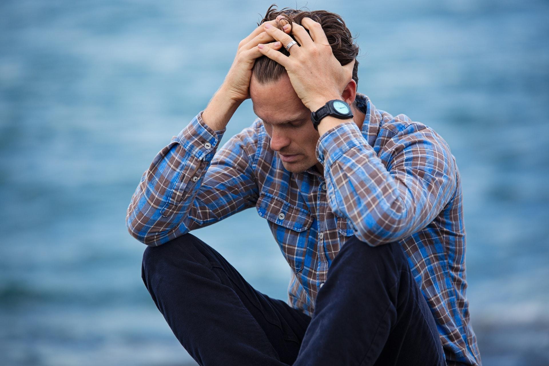 https://www.quandarypond.com/wp-content/uploads/2019/10/anxiety-anxioud-man-sitting.jpg